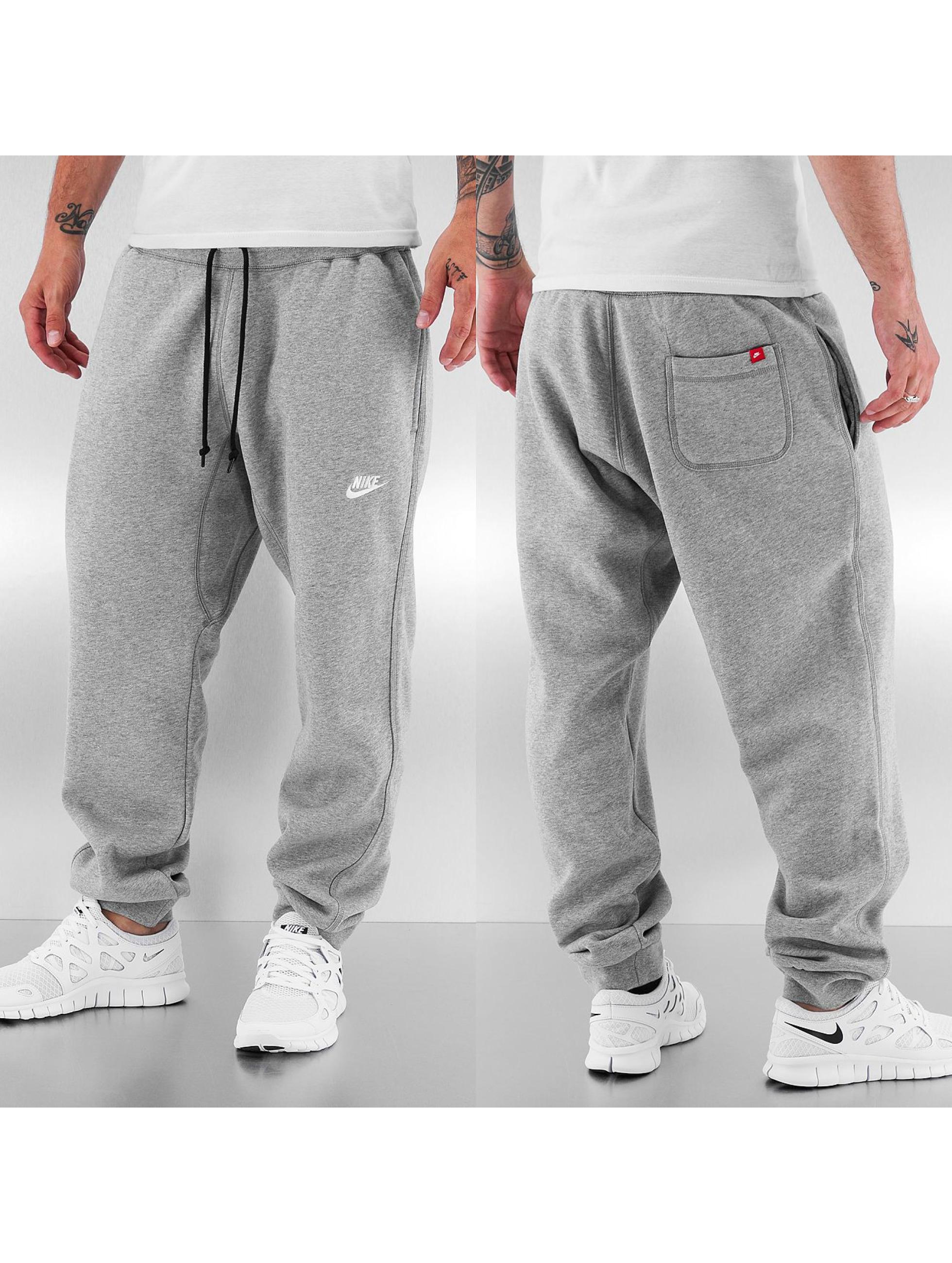 nike pantalon jogging aw77 cuff en gris 115600. Black Bedroom Furniture Sets. Home Design Ideas
