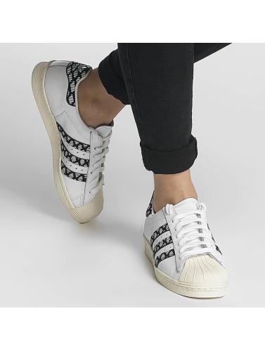 Baskets Adidas Originals Femmes Superstar Des Années 80 En Blanc meilleur endroit hyper en ligne BmIQB