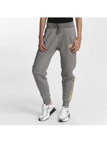 dernières collections Peu coûteux jeu Femmes Nike Pantalons De Survêtement En Rallye Métallique Gris Nsw images en ligne V0cuLNzh