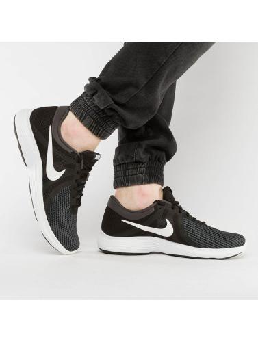 fiable vente Manchester Nike Hommes Sneakers Révolution Performance 4 En Noir 6ZtKtwx