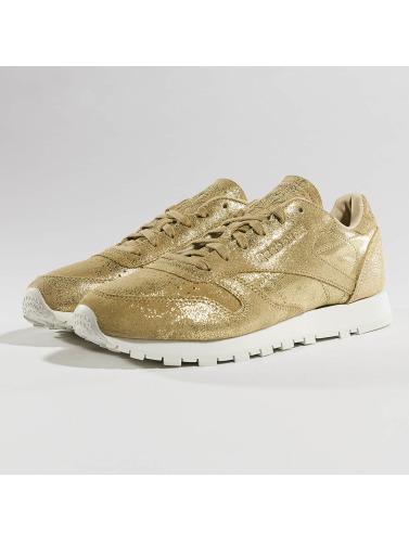 Femmes Reebok Chaussures En Cuir Classique Scintillent En Or magasiner pour ligne Footaction à vendre kfq2ZzjD