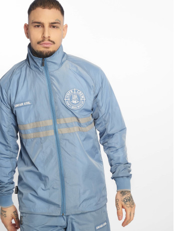 unfair-athletics-manner-ubergangsjacke-light-carbon-windrunner-in-blau
