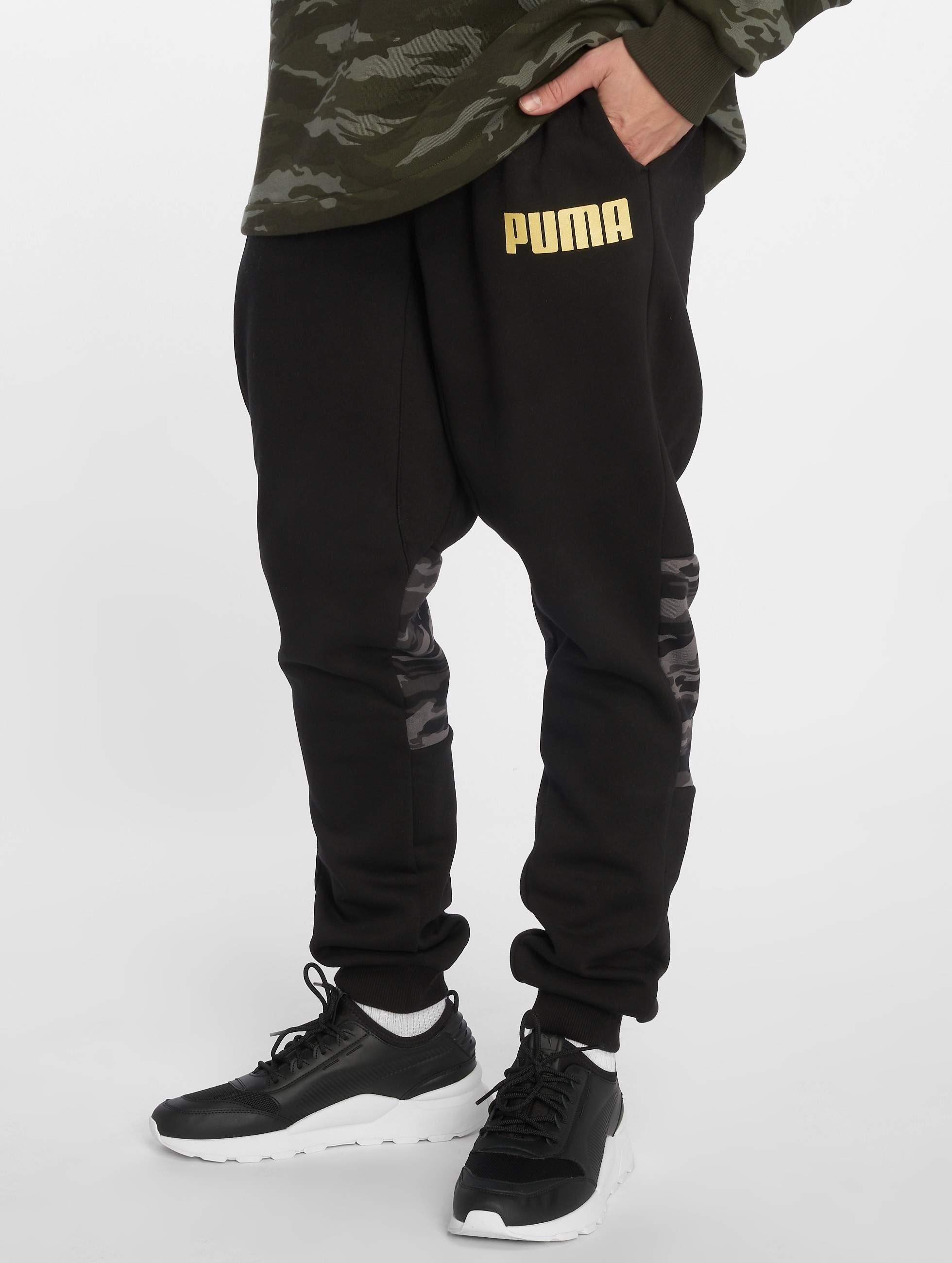 5e222df8a6a Puma broek / joggingbroek Camo in zwart 506127