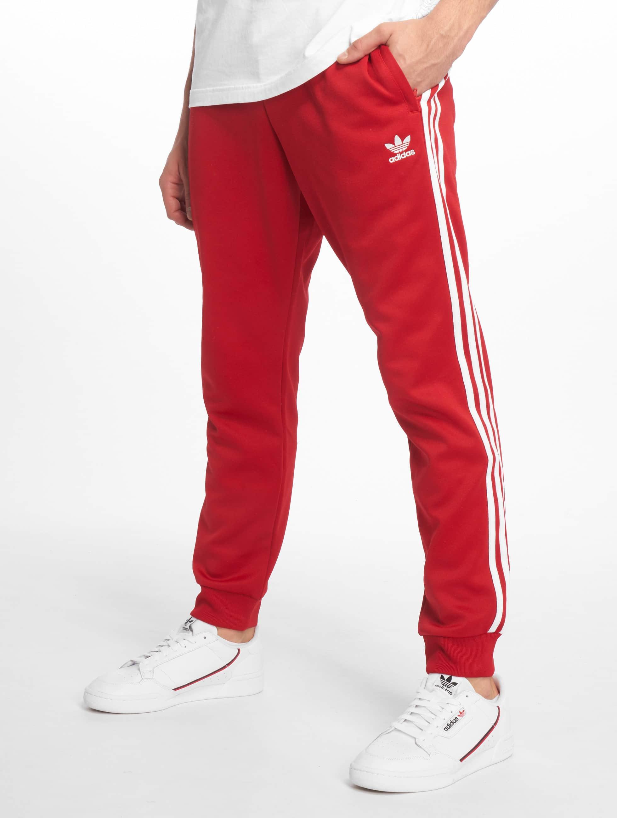 837dfe11f42 adidas originals broek / joggingbroek SST in rood 599332