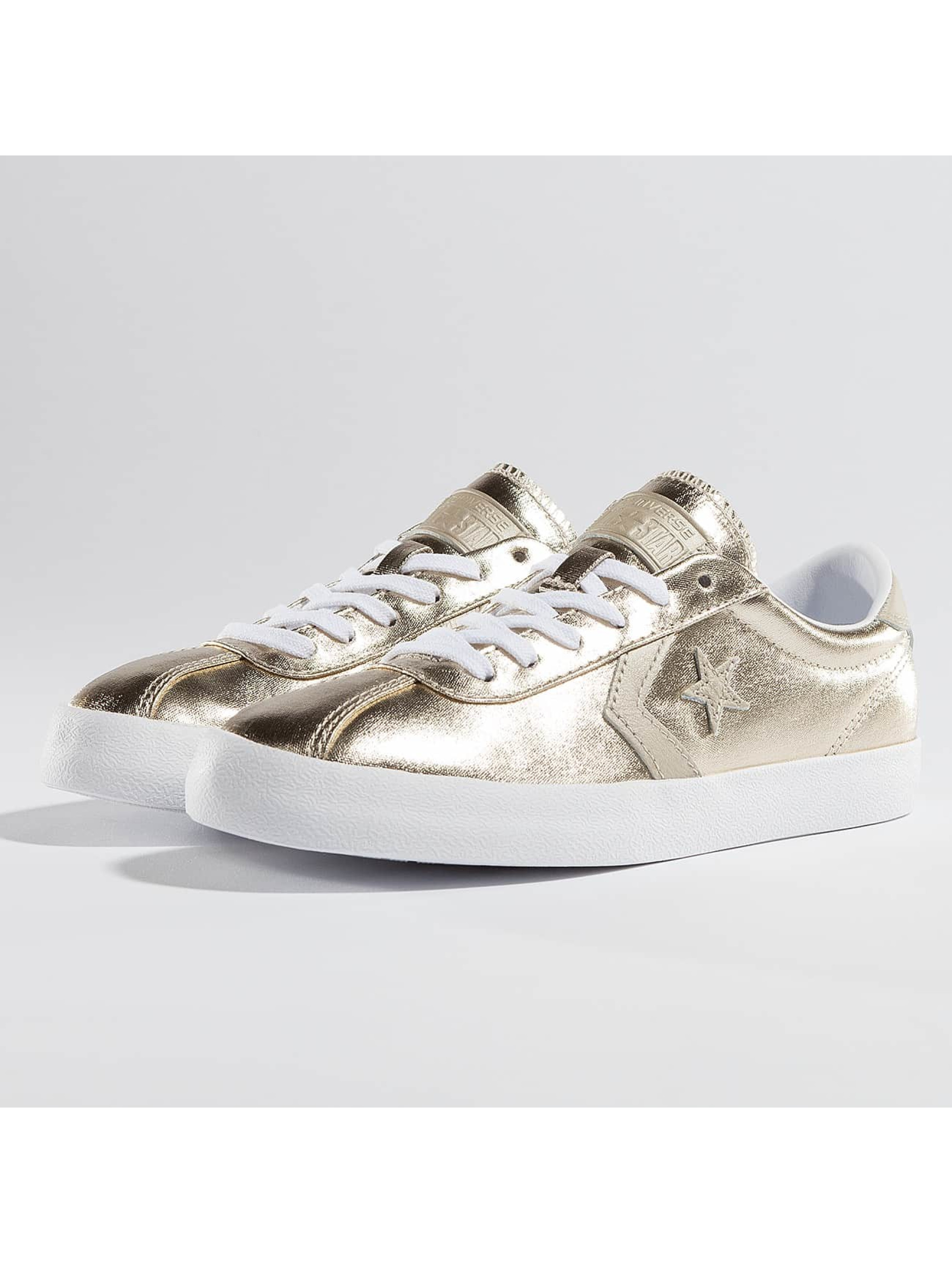 Sneaker Ox in goldfarben