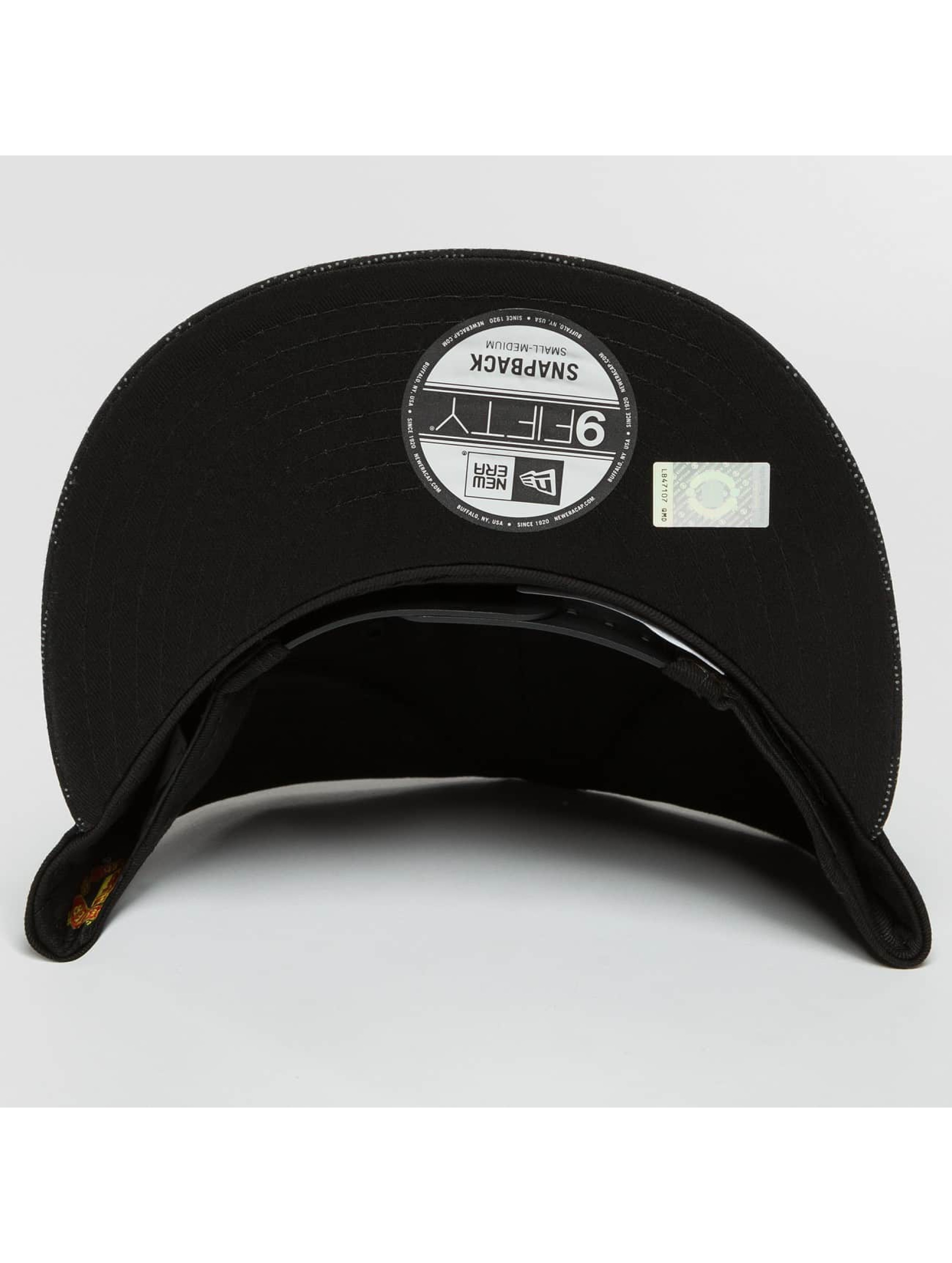 New Era Snapback Cap Reflect Camo UTD schwarz