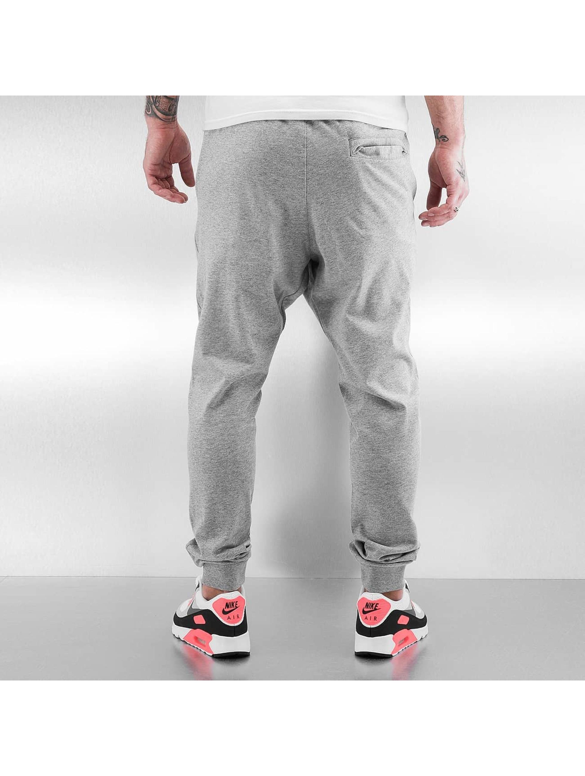 Nike tepláky Sportswear šedá