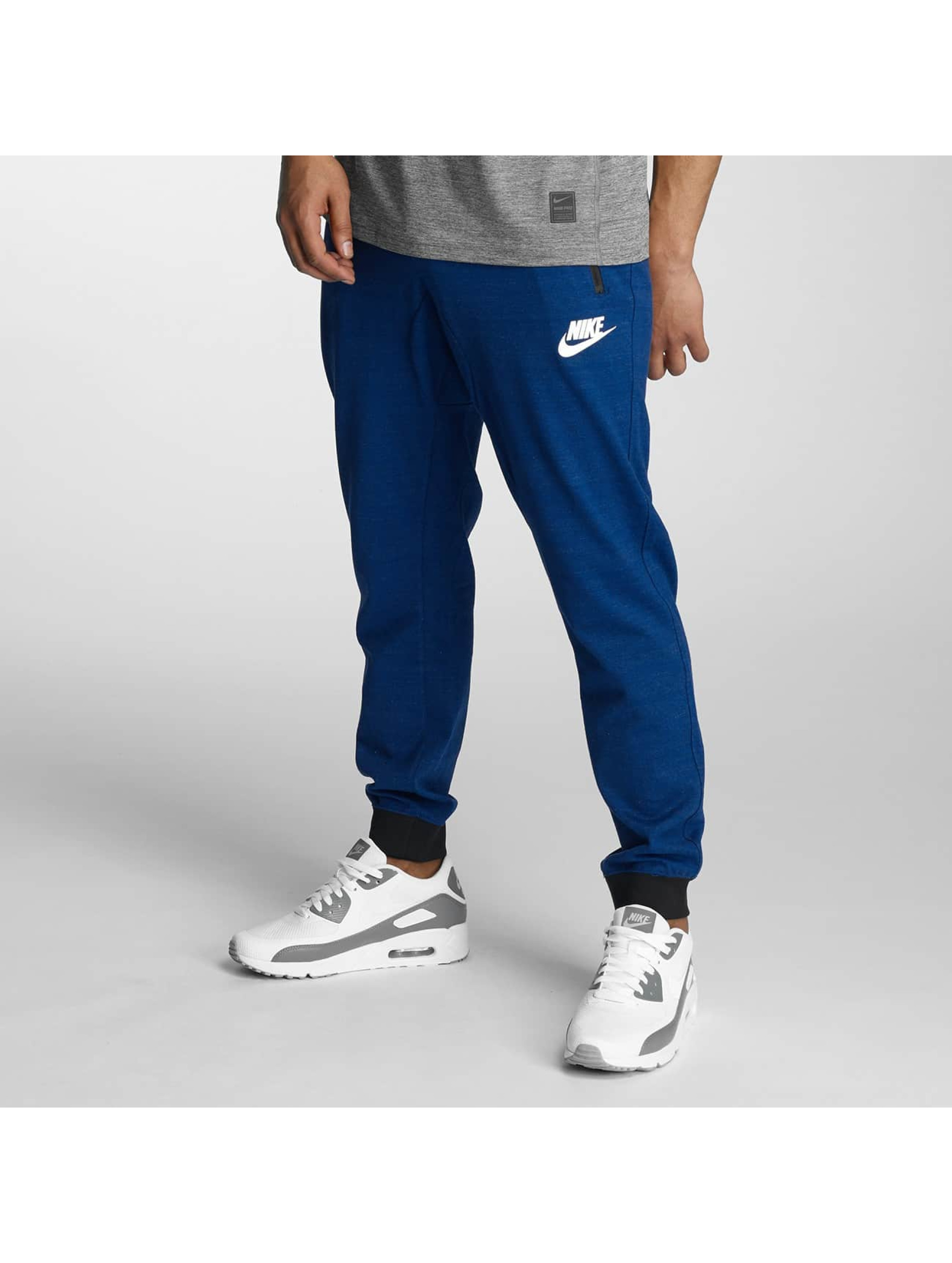Nike tepláky Sportswear Advance 15 modrá