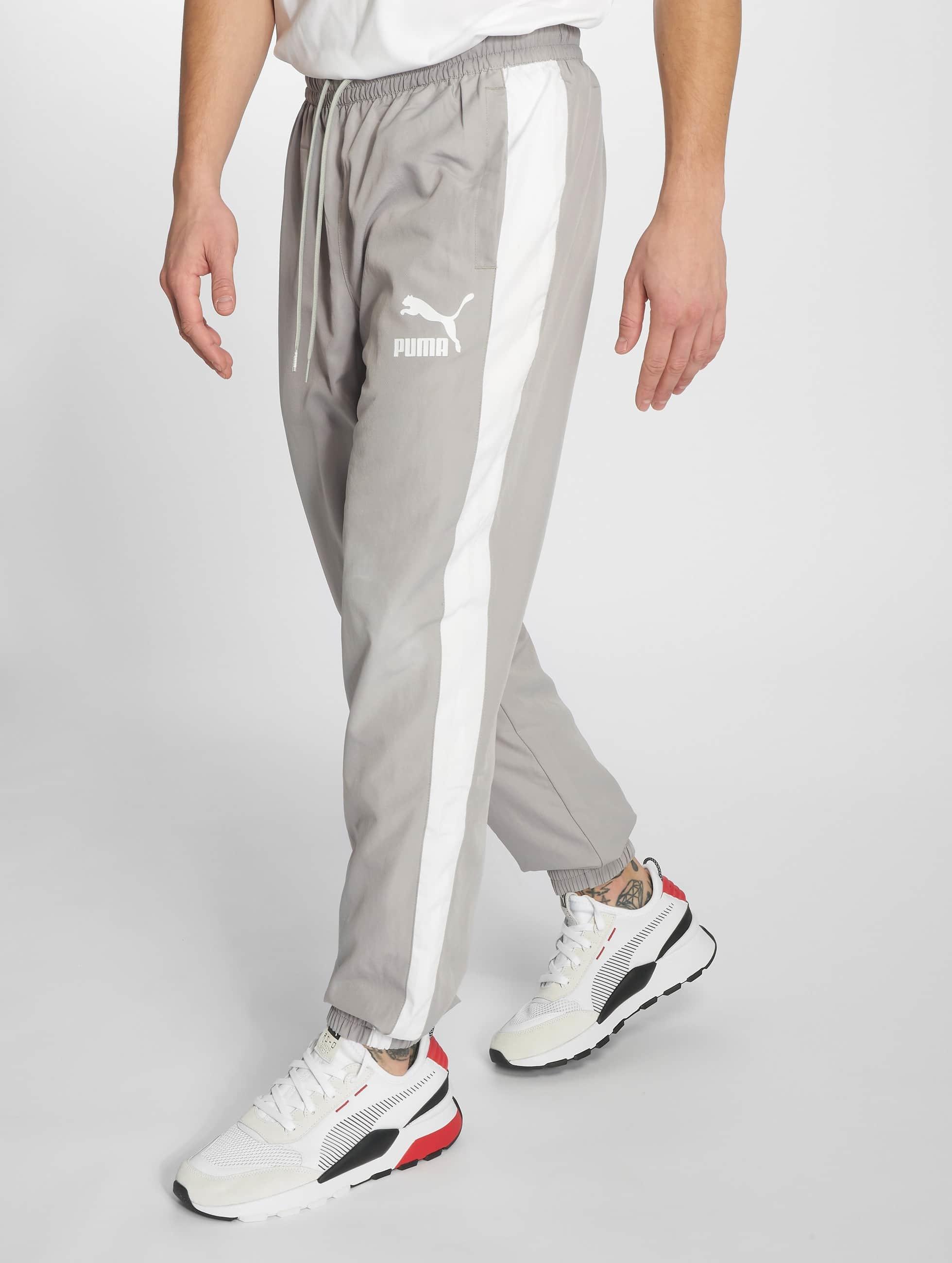 2d2f97ba9d0 Puma broek / joggingbroek Iconic T7 in grijs 607482