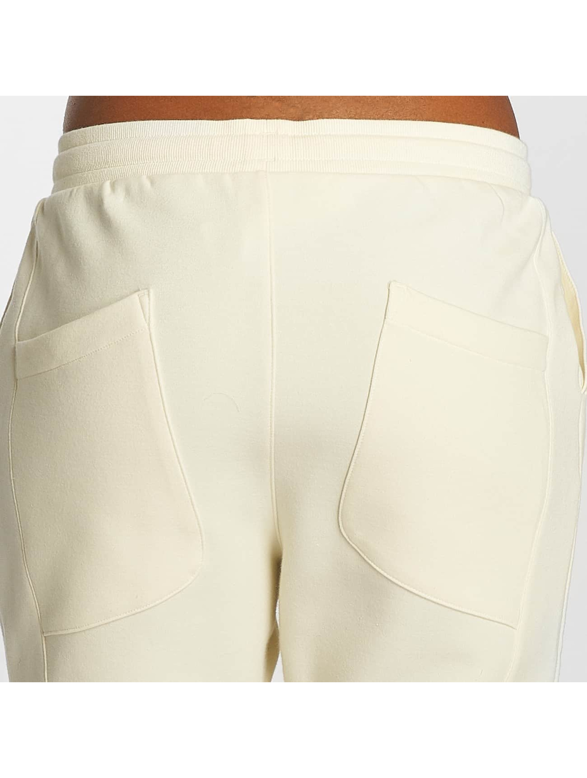 Reebok Спортивные брюки DC бежевый