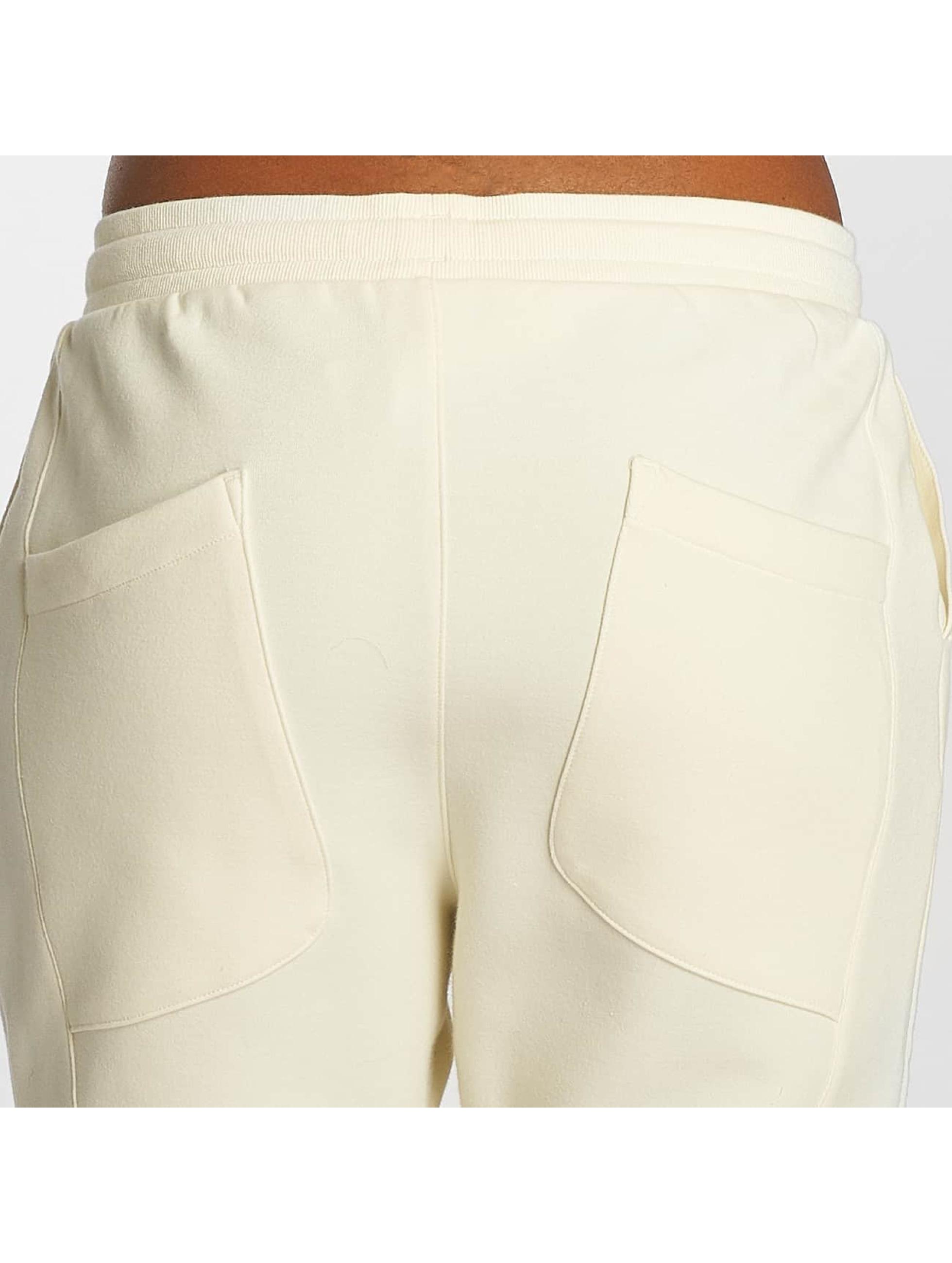 Reebok Spodnie do joggingu DC bezowy