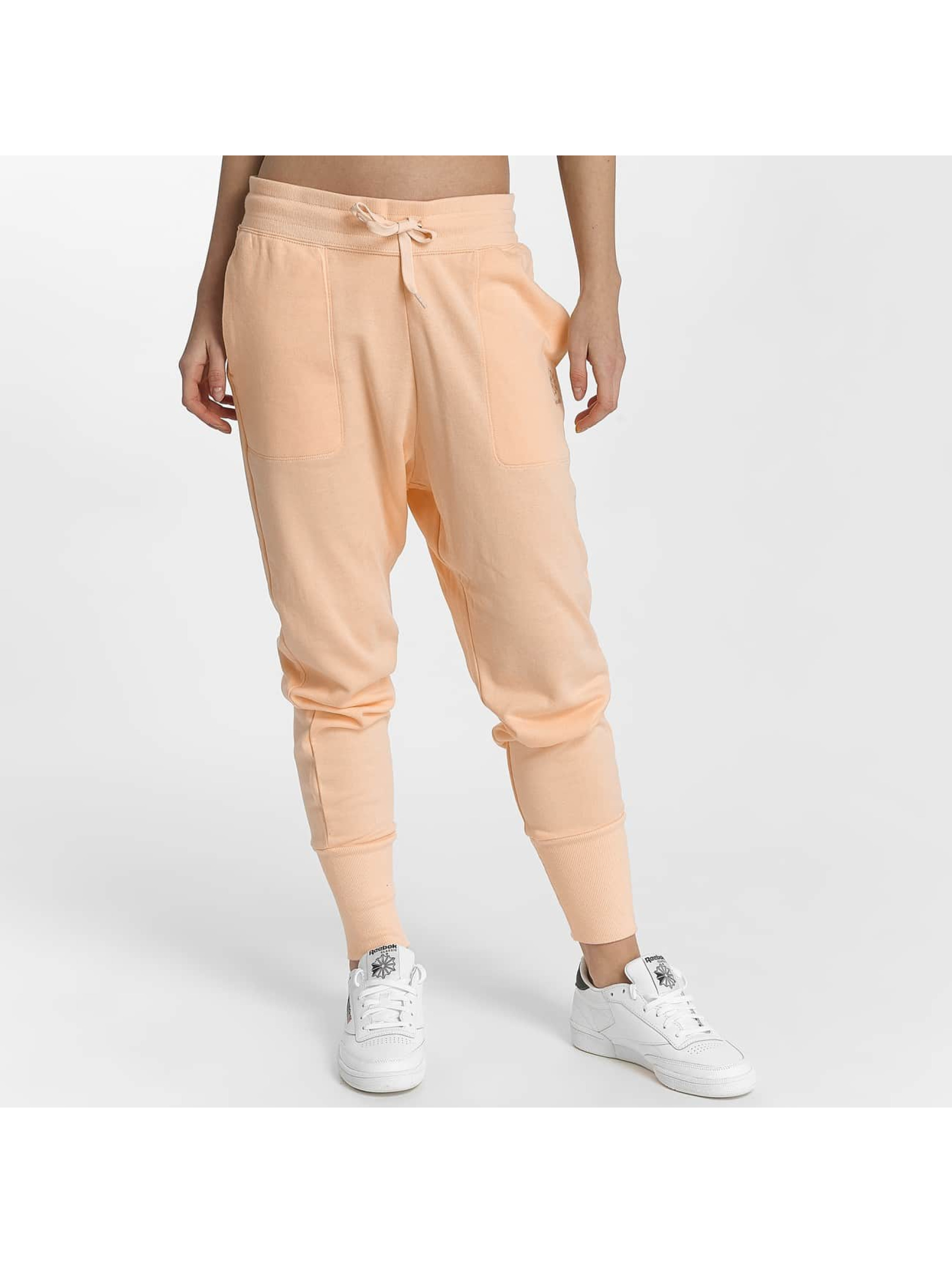 Reebok Spodnie do joggingu F Ft pomaranczowy