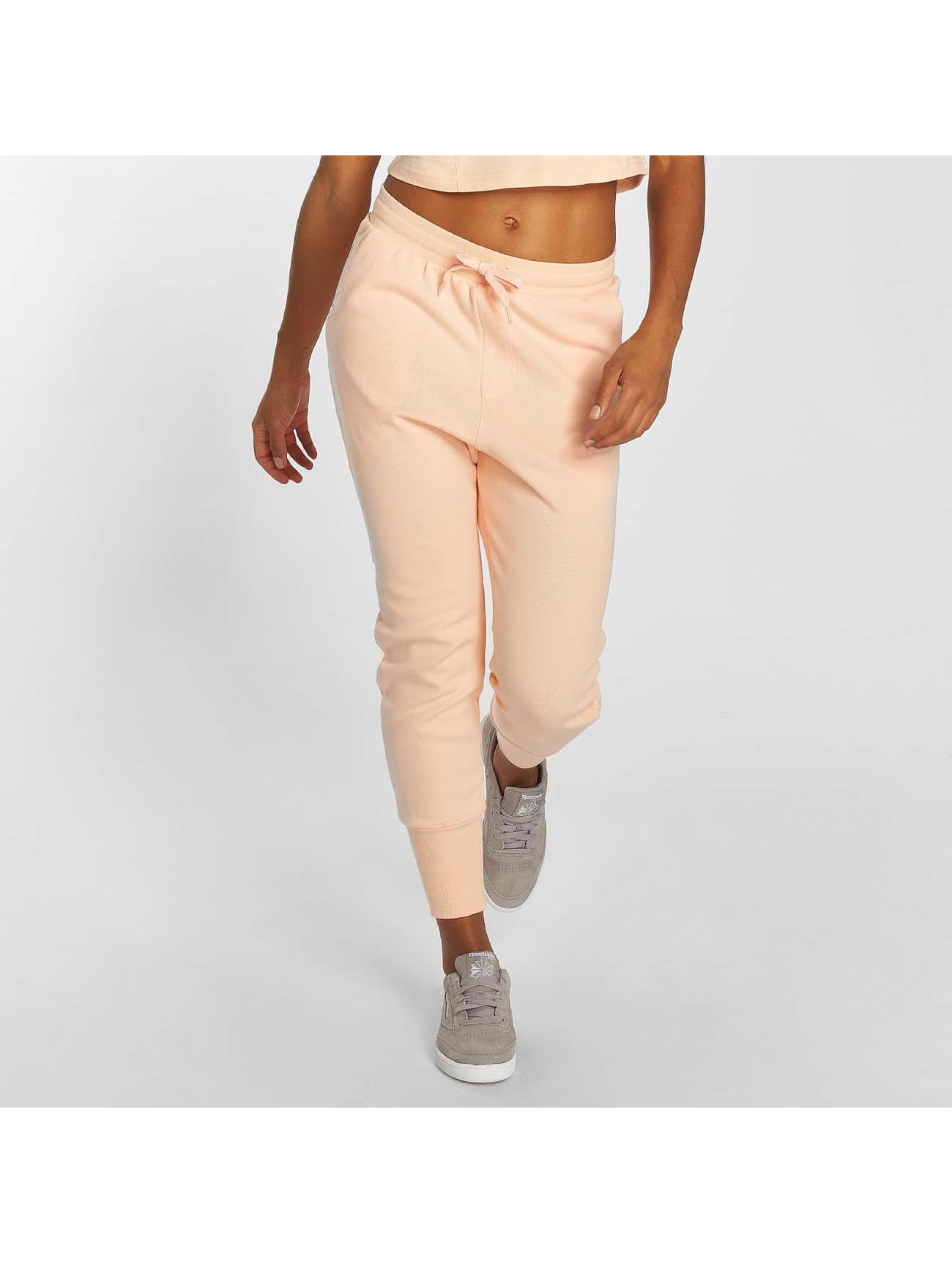 Reebok Spodnie do joggingu DC rózowy