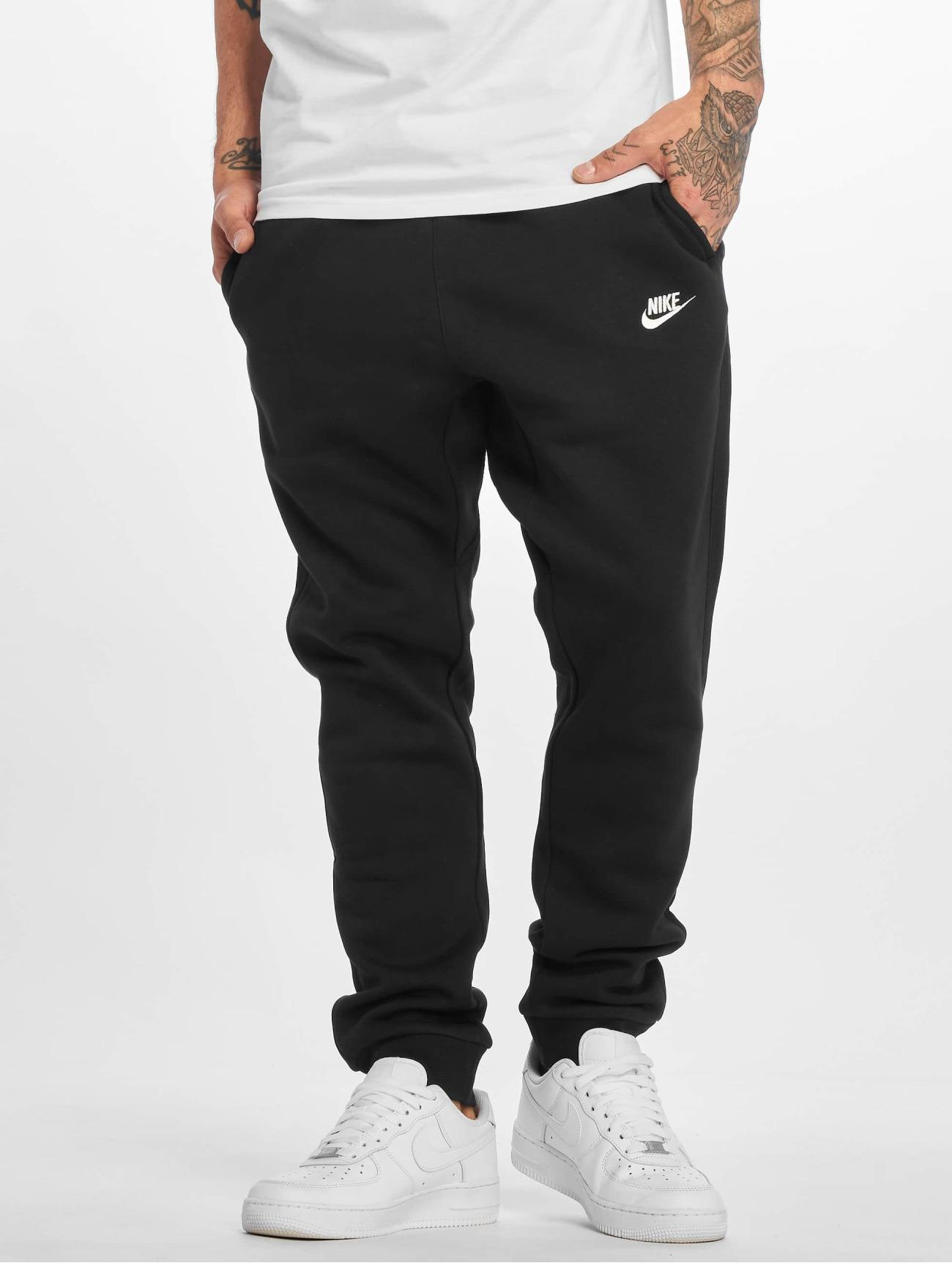 Nike Byxor / Joggingbyxor NSW FLC CLUB i svart 257534 Män Byxor