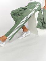 adidas originals Спортивные брюки Beckenbauer Tp зеленый