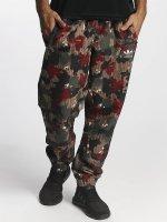 adidas originals Pantalone chino PW HU Hiking Windpants mimetico