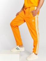 adidas originals Spodnie do joggingu Beckenbauer Tp pomaranczowy