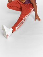 adidas originals Spodnie do joggingu Sst Tp pomaranczowy