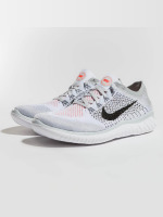 Nike Performance Baskets RN Flyknit 2018 gris