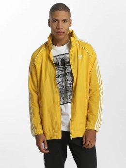 adidas originals Veste mi-saison légère Superstar Windbreaker jaune