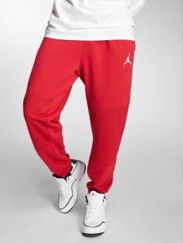 Jordan Jogging kalhoty Sportswear Jumpman Hybrid Fleece červený