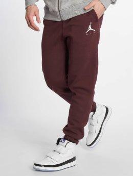 Jordan Jogging kalhoty Sportswear Jumpman Fleece červený