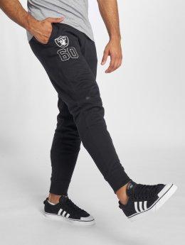 New Era Spodnie do joggingu Oakland Raiders czarny