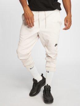 Nike Спортивные брюки Sportswear серый