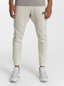 Nike joggingbroek NSW FLC CLUB beige