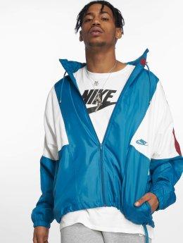 Nike Prechodné vetrovky  modrá