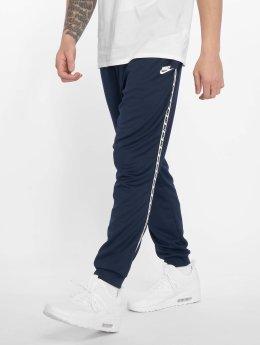 Nike Spodnie do joggingu Poly niebieski