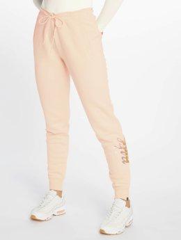 Nike Spodnie do joggingu Sportswear Rally rózowy