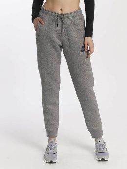 Nike Spodnie do joggingu Nike Sportswear Rally Pant szary