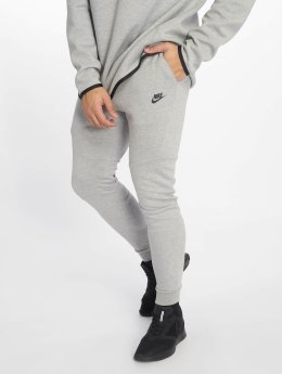 Nike tepláky Sportswear Tech šedá