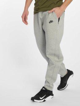 Nike tepláky Sportswear Tech Fleece šedá