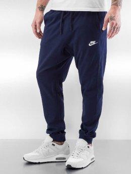 Nike tepláky Sportswear modrá