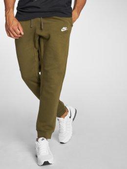 Nike tepláky Sportswear FLC CLUB olivová
