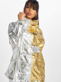 Nike Übergangsjacke Jacket goldfarben