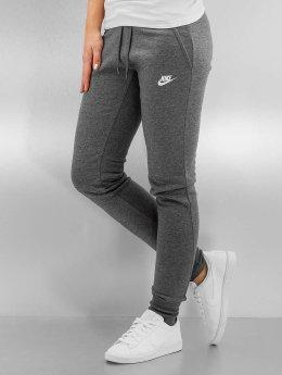 Nike Verryttelyhousut W NSW FLC Tight harmaa