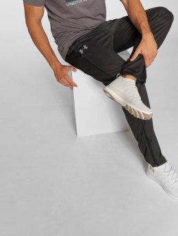 Under Armour Спортивные брюки Tech черный
