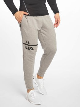Under Armour tepláky Tech Terry Tapered šedá