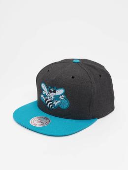 Mitchell & Ness Snapback Caps HWC Charlotte Hornets Woven Reflective šedá