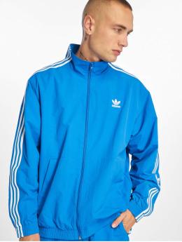 adidas originals Демисезонная куртка Woven синий