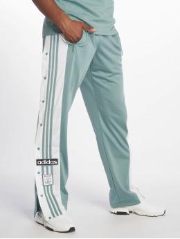 adidas originals Спортивные брюки Snap  зеленый
