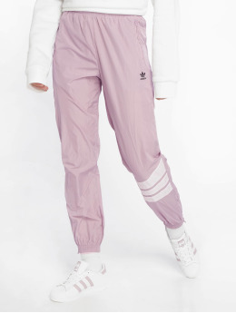 adidas originals Spodnie do joggingu Cuffed  fioletowy