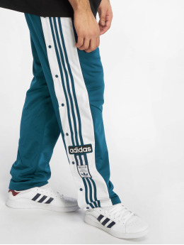 adidas originals Spodnie do joggingu Snap  niebieski