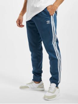 adidas Originals Spodnie do joggingu SST  niebieski