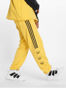 adidas originals Spodnie do joggingu Ft zólty