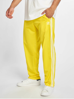 adidas originals Verryttelyhousut Firebird  keltainen