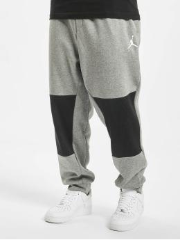 Jordan tepláky Sportswear  šedá